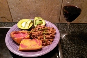 One of my fave meals: gem squash, roast butternut and avo with ostrich 'bolognaise'... and a glass of vino!